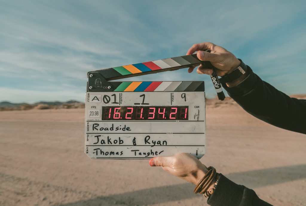 Photo of person snapping a clapperboard