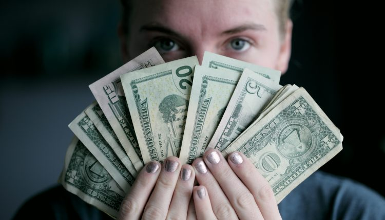 Photo of woman holding money