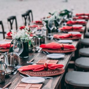 Photo of casual dinner setting on outdoor banquet table