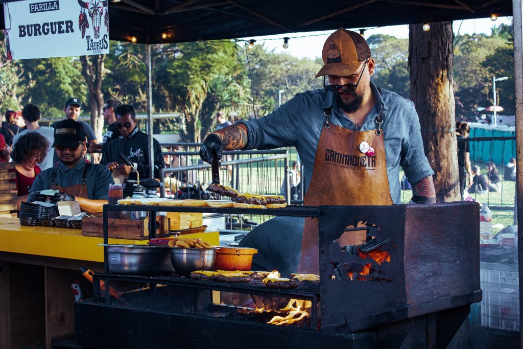 Photo of man cooking at a commercial grill