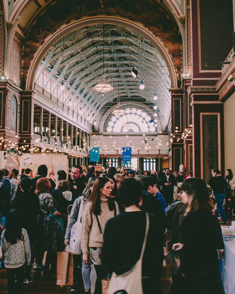 Photo of crowd of people in an exhibit hall